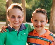 Brothers who are receiving pediatric orthodontics
