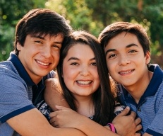 Three teen siblings with braces