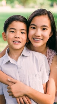 Preteen sister and brother with pediatric orthodontics