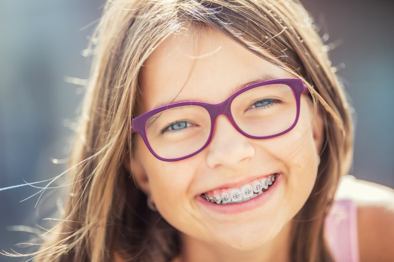 young girl learning braces treatment time in Richardson